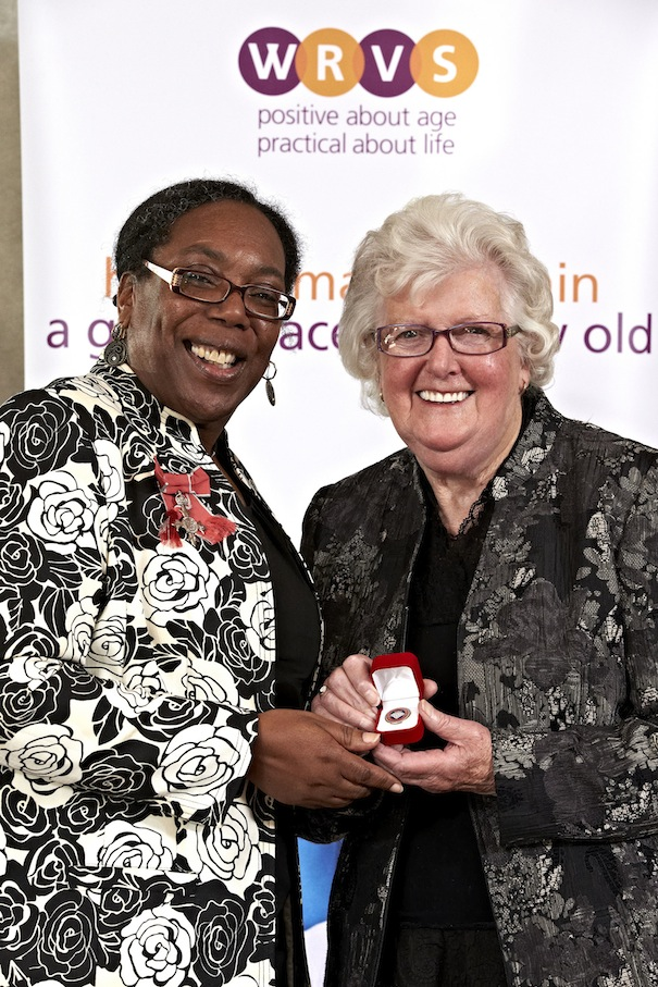 Margaret Veal receives her Diamond Champion pin